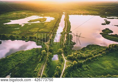 Rural Summer Sunset Landscape With River, Lakes, Swamp And Sunshine, Natural Background, Aerial View