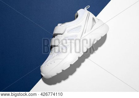 Top View Macro On The Side One White Sneaker With Velcro Fasteners For Easy Footwear On A Modern Blu