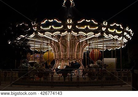 Retro Merry-go-round In The Evening In Summer, Vintage Carousel Lights In The Park.