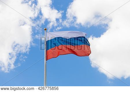 Waving Russian Tricolor. The Flag Of Russia Flutters In The Wind On A Sunny Day. Flag Of The Russian