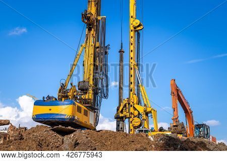 Construction Machinery At The Construction Site. Bauer Bg 36 Rotary Drilling Rigs And Excavator Buil