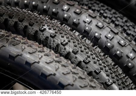 Group Of New Bicycle Tires. Rubber Tires Close Up. Bicycle Tires With Different Tread Patterns. Sele