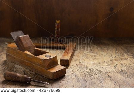 Woodworking tools on wooden table. Wood plane jointer carpenter tools or joiner tool as still life. Carpentry workshop