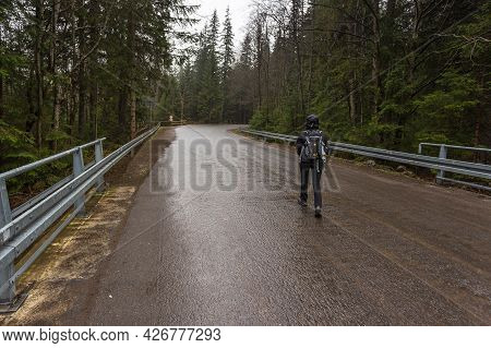 Bukowina Tatrzanska, Tatra Mountain Poland - 10 April 2016: Tourist On The Road. Bialki Valley On A