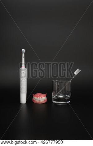 Oral Hygiene. Dental Prosthesis Care. Dental Care With A Brush. A Toothbrush Or A Simple Brush. Toot