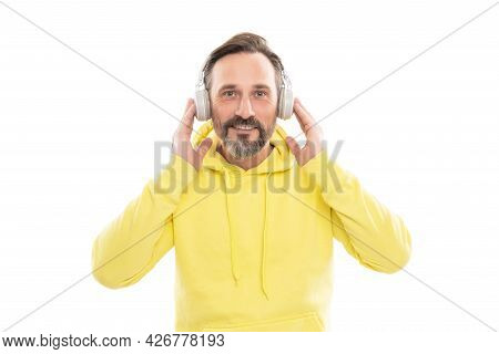 Looking So Stylish. Man In Yellow Hoody And Earphones. Online Education Of Adult Guy.