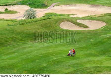 Ukraine, Kharkiv, June 2021. Green Grass And Holes On The Golf Course. Golf Field On A Sunny Summer