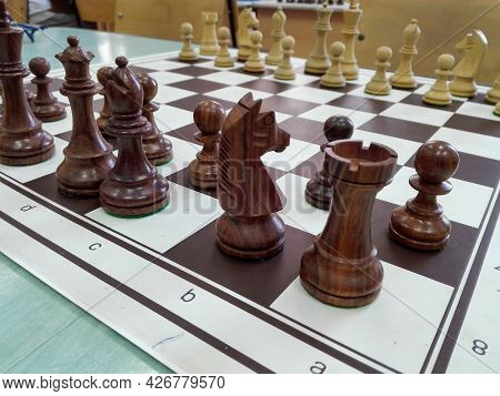 Wooden Chess Figurines On A Chess Table
