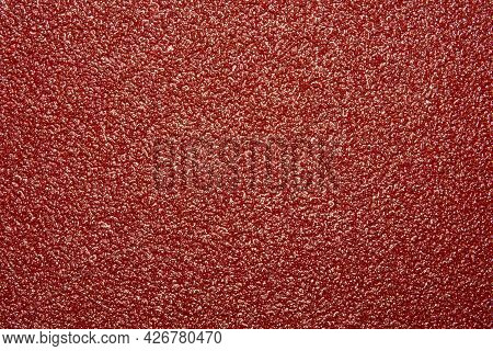 Sandpaper.the Texture Of Red Coarse Sandpaper.the Background Is Made Of Red Sandpaper.
