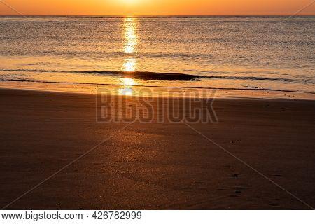 Wild Dunes Resort, South Carolina, Usa - April 5, 2021. An Early Morning Golden Sunrise Beachfront S