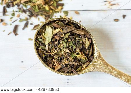 Loose Green Tea Blend And A Pretty Gold Spoon.