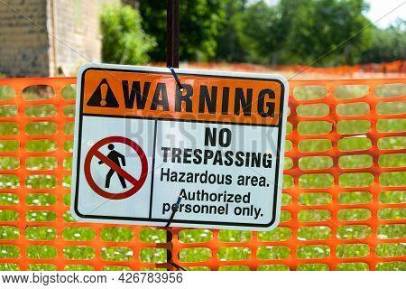 A Warning Sign Indicating No Trespassing Indicating A Hazardous Area.