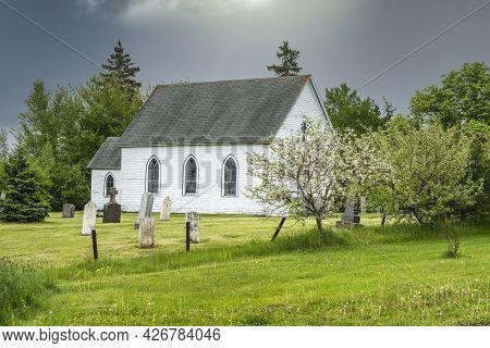 Old Abandoned Church In A Rural Springtime Landscape.