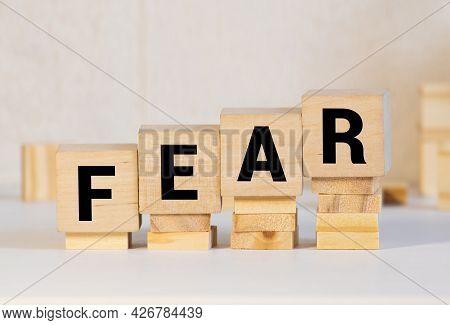 Fear Word Written On Blocks. Posttraumatic Stress Disorder Inscription On Yellow Background. Medical