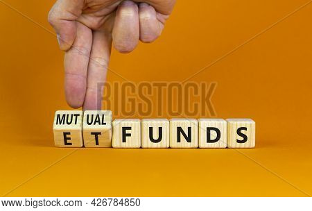 Mutual Funds Vs Etf Symbol. Businessman Turns Cubes And Changes Words 'etf, Exchange-traded Fund' To