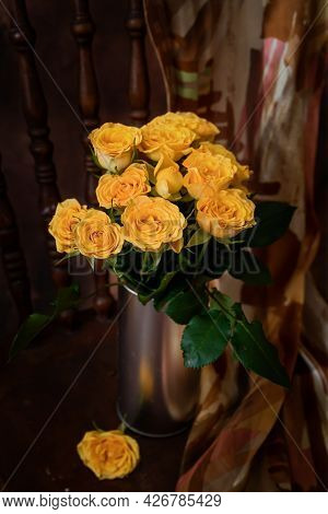 Pretty Bouquet Of Little Yellow Roses In A Vase.