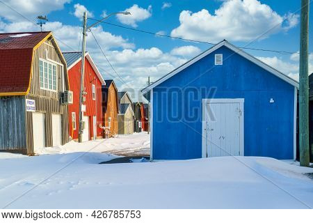 Commercial Fishery Buildings On The Wharf During Winter In Rural Prince Edward Island, Canada.