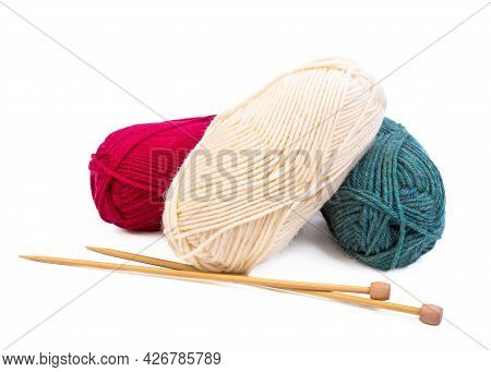 Balls Of Yarn With Wooden Knitting Needles On A White Background.