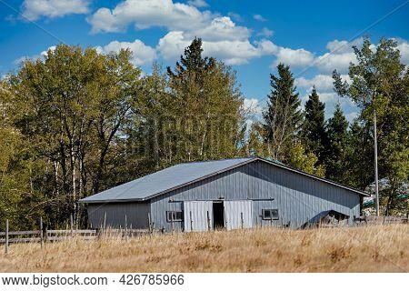 Old Wooden Barn In The Rural Alberta Landscape.