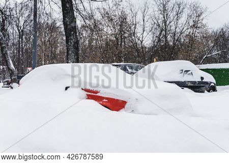 Cars Among Snow Drifts, Parking After Heavy Snowfall, City Landscape. Weather Concept