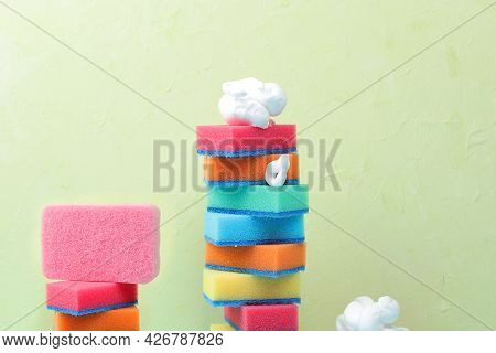 Colored Sponges For Washing Dishes And Cleaning In A Sunny Room. The Concept Of Cleanliness In The H