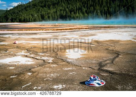 A Bucket Hat Was Dropped And Littered By A Tourist In The Grand Prismatic Spring In Yellowstone Nati