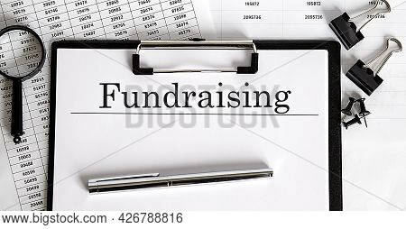 Document With Sign Fundraising With Chart, Pen And Magnifier,business