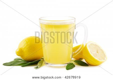 Hot lemon drink with sage leaves on white