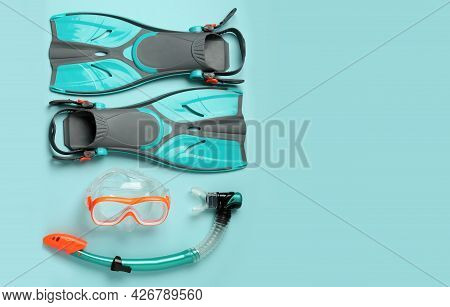 Pair Of Flippers, Snorkel And Diving Mask On Color Background, Flat Lay