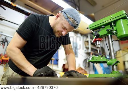 Metalwork Craftsman Is Working With Metal At Workshop. Do It Yourself. Small Local Business.
