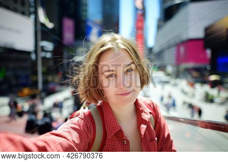Beautiful Young Woman Tourist Taking Selfie On Times Square On Sunny Summer Day, Downtown Manhattan.
