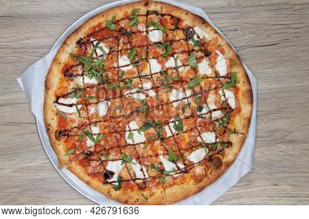Overhead View Of Crispy Crust On This Bruschetta Pizza Loaded With Toppings And Drizzled With Sauce