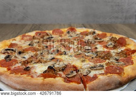 Melted Cheeses Covers This Mushroom And Pepperoni Pizza With The Crispy Crust Cooked To Perfection.