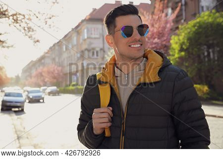 Happy Male Tourist Sightseeing Outdoors On Spring Day