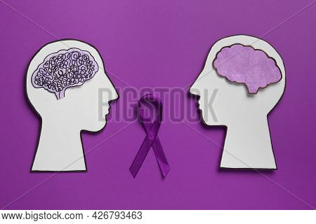Human Head Cutouts With Different Brains And Purple Ribbon On Color Background, Flat Lay. Epilepsy A