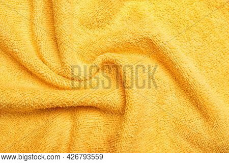 Crumpled Orange Microfiber Cloth As Background, Closeup