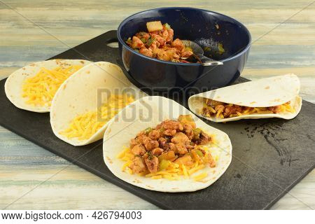 Making Bbq Chicken Pineapple Quesadillas By Filling Tortillas With Shredded Cheese And Cooked Fillin