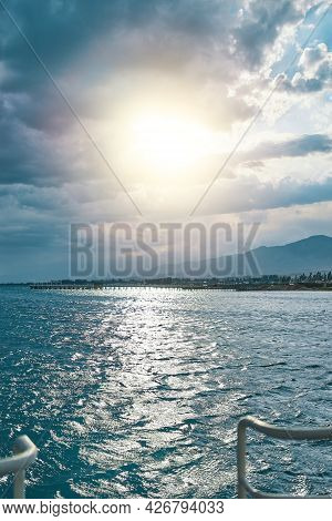 Sunny Day At Sea. Resort Town On Horizon. Morning Sun Over Blue Ocean. Beautiful Water Highlights. T