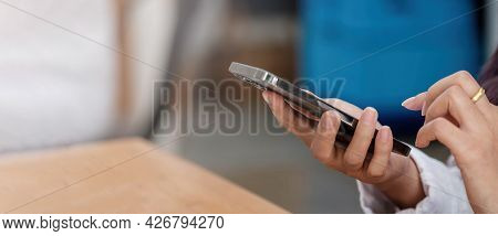 Close Up Of Woman Using Cellphone And Typing Text Message On Smartphone Device