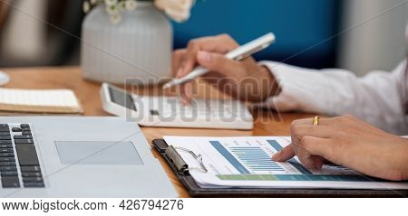 Accountant Using A Calculator To Calculate The Numbers. Accounting , Accountancy From Financial Repo