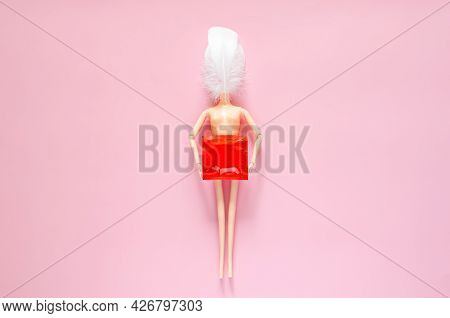 Naked Doll Holding Condom Package For Minimal Safe Sex, World Sexual Health And Aids Day Concept.