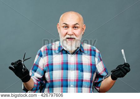 Portrait Of Stylish Man Bearded Man With Grey Moustache Beard. Old Barber With Scissors And Razor. V