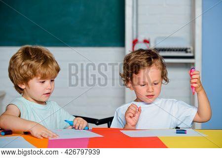 Happy Cute Clever Boys Pupils Drawing. Kids Funny Education. Preschool Childrenhaving Fun. Kids Read