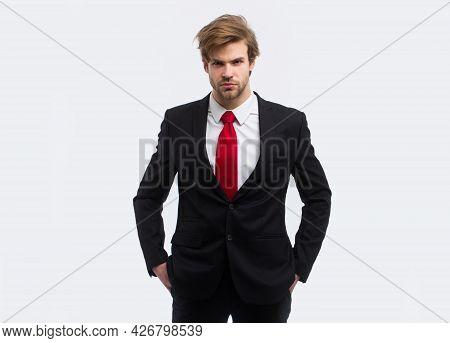 Man In Formal Suit With Hands In Pockets Isolated Over White Background.