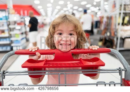 Child With Shopping Basket Purchasing Food In A Grocery Store. Customers Kid Buying Products At Supe