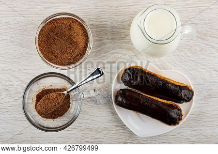 Cocoa Powder With Sugar In Transparent Bowl, Pitcher With Hot Milk, Teaspoon And Cocoa In Transparen