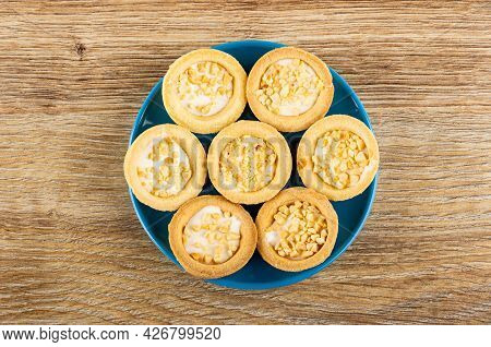 Peanut Cookies Tartlets In Blue Saucer On Brown Wooden Table. Top View