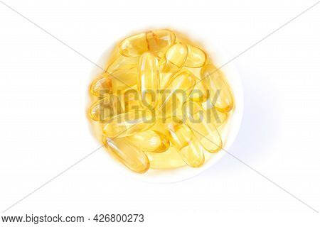Bowl Of Cod Liver Or Fish Oil Capsules With Omega 3, Supplements For Help Your Health Top View