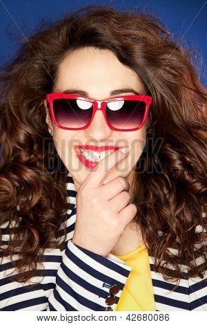 Beautiful happy young woman wearing sunglasses