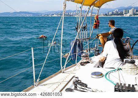 People Swim In The Open Sea, Excursion To The Black Sea In Sochi. Sochi, 08.07.2021